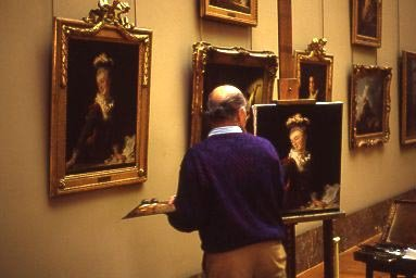 Artist painting inside the Louvre near the Mona Lisa